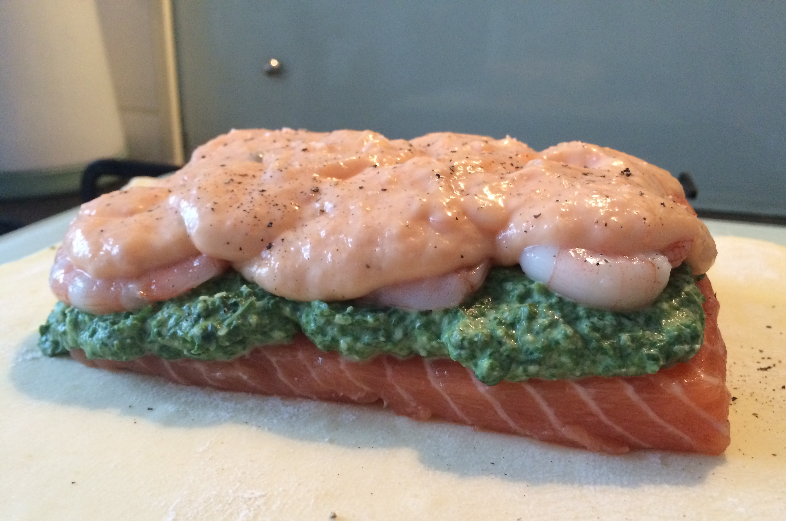 Place Your Salmon Fillet In The Middle Spread The Spinach Filling Over The  Top Place The King Prawns On Top Of The Spinach Spread The Salmon Mousse  On